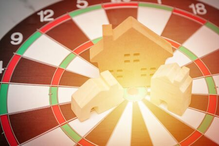 House in the middle of the target center of dartboard concept of success the goal of completion