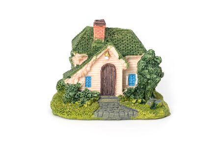 Mini house model on white background