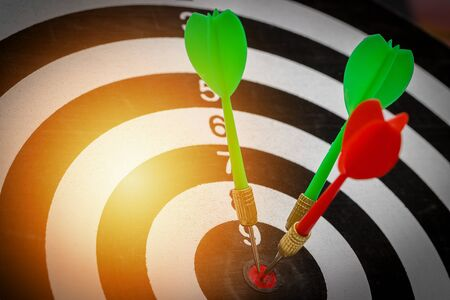 Success hitting target goal achievement  three darts arrows in the target center business goal concept 写真素材
