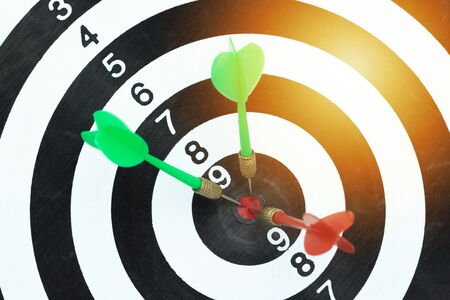 Successful business planning with a goal that has an arrow in the center of the target.