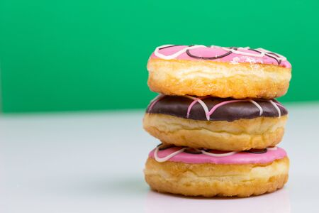 Colorful donuts stacked isolated on white background
