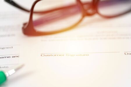 Sign on contract document with fountain pen and glasses on white background Reklamní fotografie