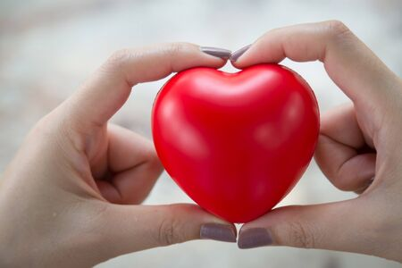 Woman hold red heart use for background