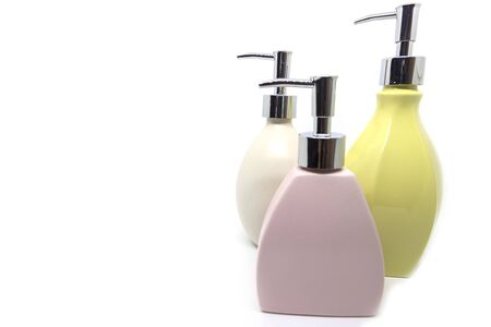 Modern multi-colored shower gel bottles on a white background Reklamní fotografie