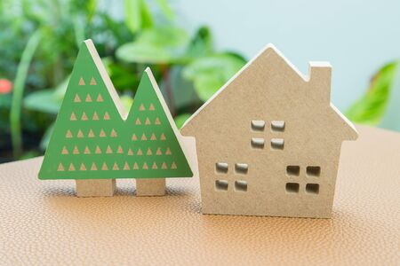 The model concept family house with tree garden background