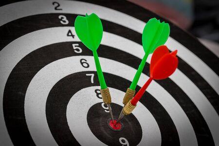 Success hitting target goal achievement  three darts arrows in the target center business goal concept Reklamní fotografie
