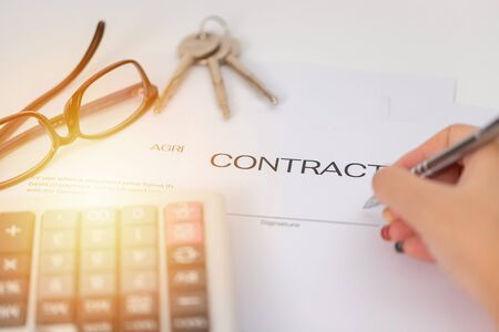 Sign a business contract with a key  background Reklamní fotografie
