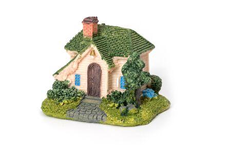 Mini house model on white background
