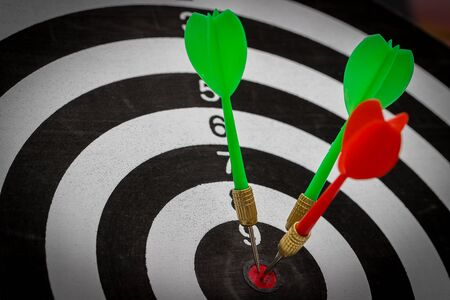 Success hitting target goal achievement  three darts arrows in the target center business goal concept 版權商用圖片