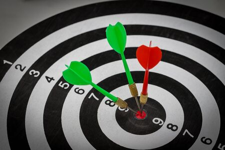 Success hitting target goal achievement  three darts arrows in the target center business goal concept Imagens
