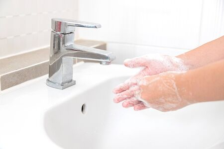 Washing your hands with soap for cleaning helps prevent germs and Covid-19