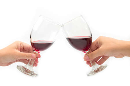 Cheer a glass of two red wine isolated on a white background.