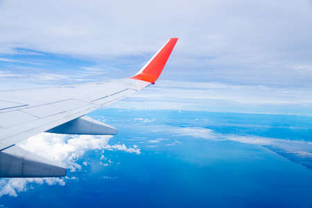 Airplane wing On the blue sky natural background