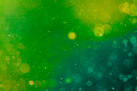Abstract elegant green glitter sparkle bokeh with black background