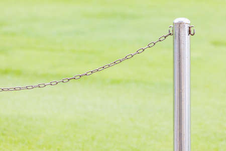 Iron pole with chains in golf course