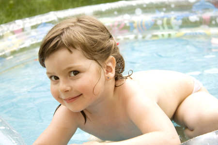 without clothes: The beautiful girl artfully looks a summer sunny day from pool Stock Photo