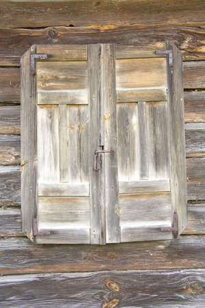 The old window from a tree is closed by shutters Stock Photo - 7239317