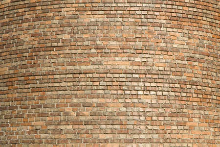 creative potential: Old tower from small multi-coloured bricks Stock Photo