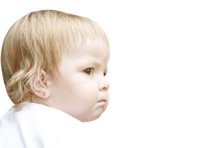 The small child looks aside having inflated cheeks Banco de Imagens
