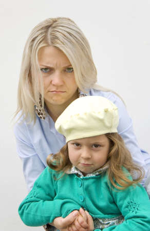 frowned: Gloomy woman and the small child on the white