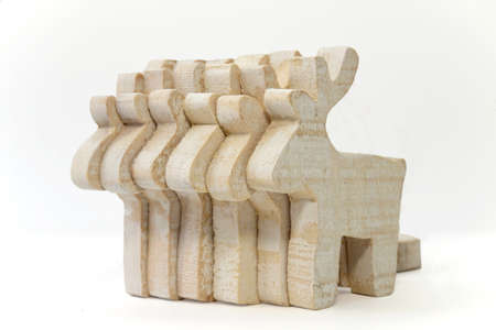 Team of toy wooden deer on the white photo