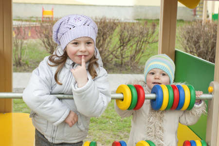 Little girls play a platform in the spring Stock Photo - 9397630