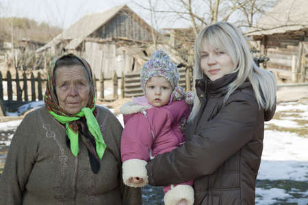 grand daughter: The grandmother the grand daughter and mum stand together against old village