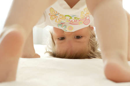 The child costs on a head head over heels Stock Photo - 9644534