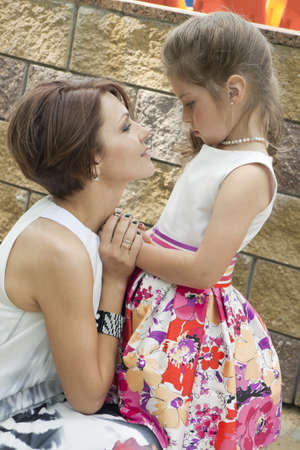 pardon: Mum holds a daughter for hands and is sorry Stock Photo