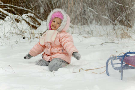 rejoices: child rejoices to falling snow  Winter games in snow