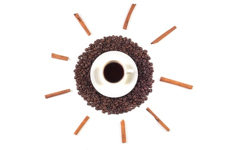Cup of coffee on coffee beans with rays of cinnamon