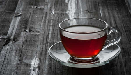 A cup of black tea on a black table Stock Photo