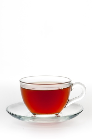 A cup of black tea on a white background