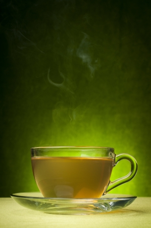 tea cup: Green tea on a green background Stock Photo