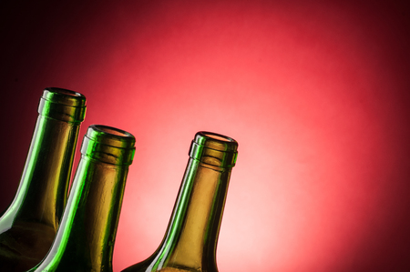necks of the bottles on the red background Stock Photo