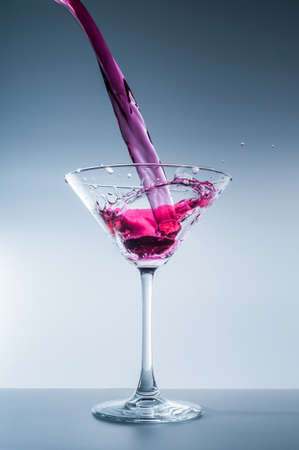 Alcohol is poured into a glass