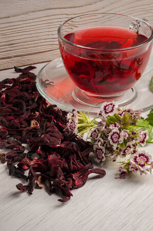 Hibiscus and carnation flowers tea photo