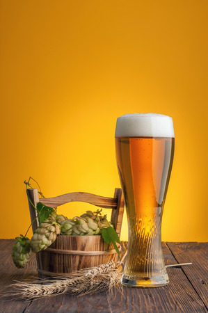 Beer on table with yellow background