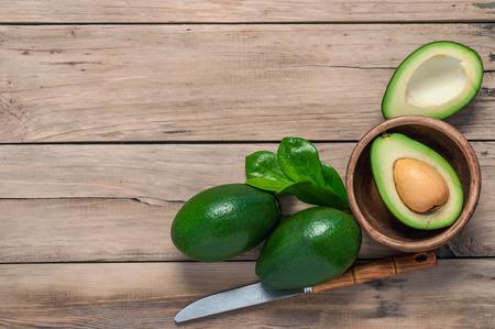 avocado on a wooden table old Фото со стока
