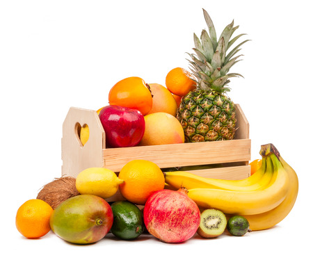 Composition of tropical fruits in a basket and near it isolated on white background photo