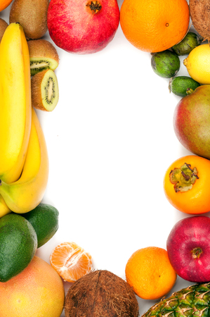 Composition of tropical fruits as a frame isolated on white background photo