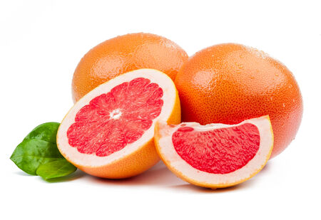 Two grapefruit and slices with leaves isolated on white background Stock Photo