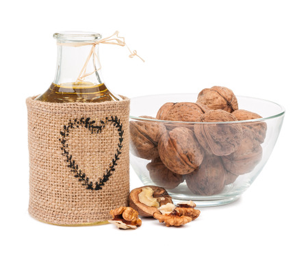 walnut oil and nuts isolated on white background Stock Photo