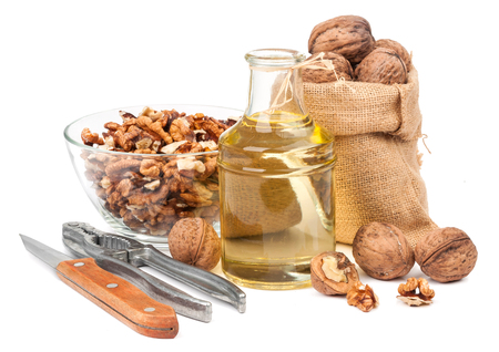 composition of walnut and walnut oil isolated on white background