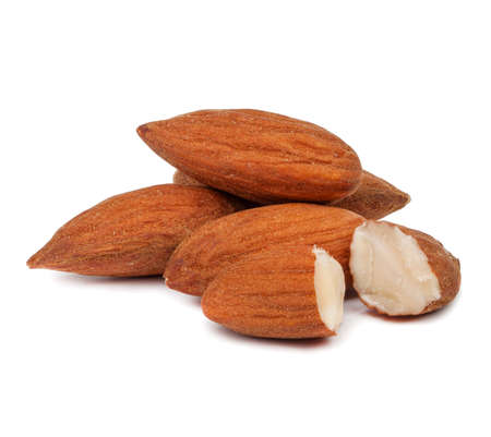 handful of almonds isolated on white background Stock Photo