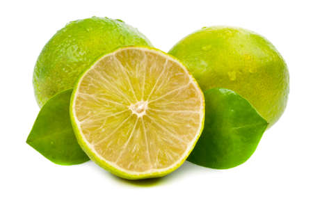 limes and slice with leaves isolated on white background Stock Photo