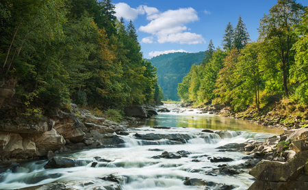 mountains and sky: mountain river with waterfall Stock Photo