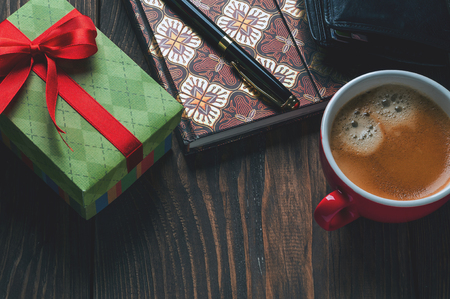 birthday present: gift box and a cup of coffee on the table