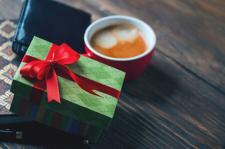 gift box and a cup of coffee on the table