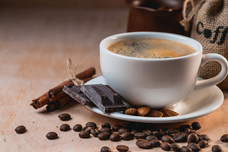 cup of coffee and coffee beans on the table Stock Photo